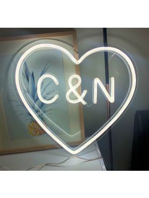 Small LED neon heart light that can be personalised with your initials, displayed on a desk - photo from Custom Neon by Neon Collective