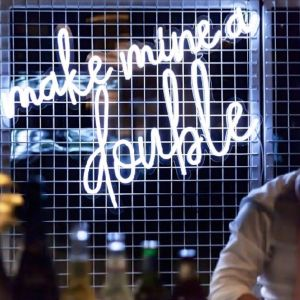 Make Mine a Double trendy LED neon bar sign behind the open bar at an event - photo from CustomNeon.com