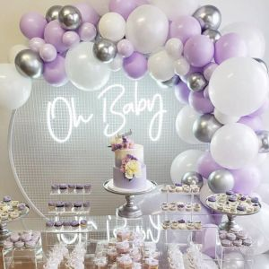 Oh Baby baby shower sign shown surrounded by balloons and cakes - photo from Custom Neon by Neon Collective