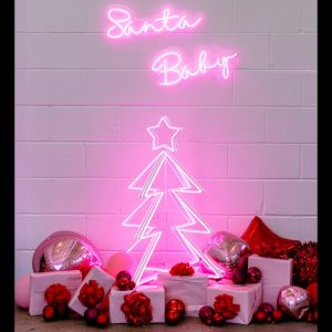 3D Neon Christmas Tree shown with presents and a Santa Baby neon sign - photo from Custom Neon by Neon Collective